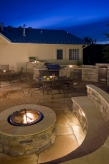 Outdoor Kitchen with Firepit & Seating Area
